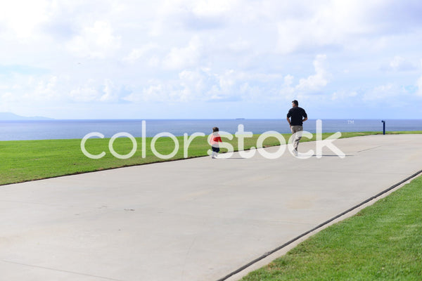Father and child enjoying the outdoors - Colorstock™  © PorterhouseLA  - diverse stock photos