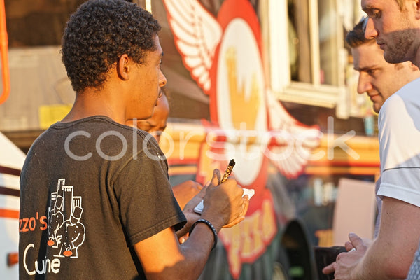 Food truck vendor accepting orders - Colorstock™  © David Huff  - diverse stock photos