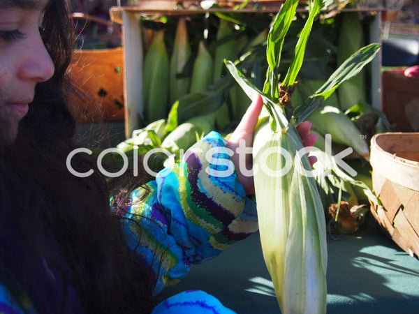 Girl holding vegetables at farmer's market - Colorstock™  © Jenifer Daniels  - diverse stock photos