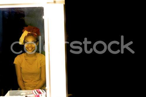 Girl smiling in the mirror - Colorstock™  © David Huff  - diverse stock photos
