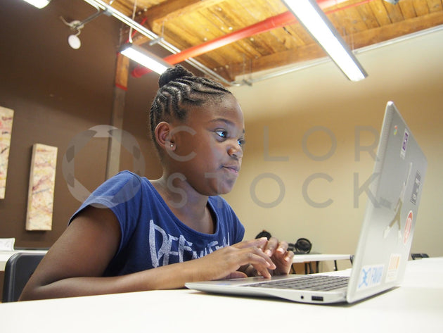 Girl using her laptop in class - Colorstock™  © Jenifer Daniels  - diverse stock photos
