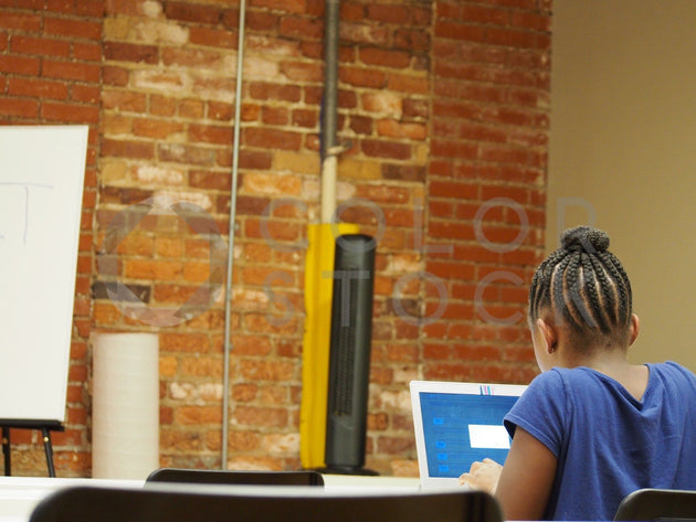 Girl using her laptop, learning to code - Colorstock™  © Jenifer Daniels  - diverse stock photos