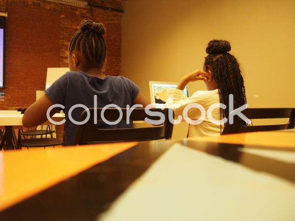 Girls learning to code - Colorstock™  © Jenifer Daniels  - diverse stock photos