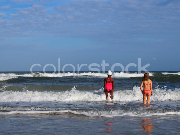 Girls playing in the ocean - Colorstock™  © Jenifer Daniels  - diverse stock photos