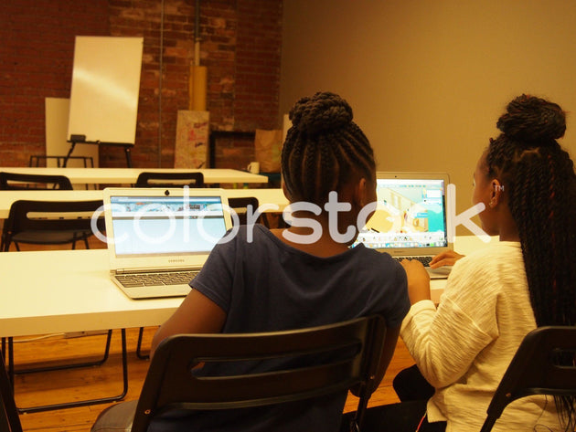Girls sharing a joke while looking at laptop screen - Colorstock™  © Jenifer Daniels  - diverse stock photos