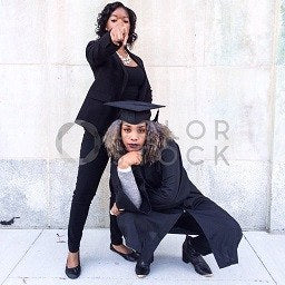Graduates posing in the city - Colorstock™  © Jenell Hairston  - diverse stock photos