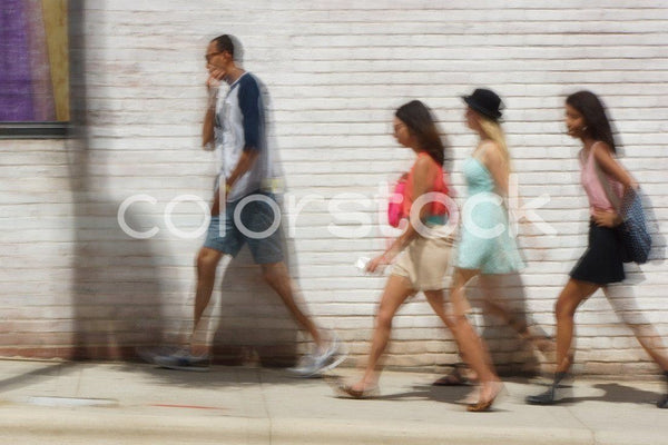 Group of people walking in the city - Colorstock™  © David Huff  - diverse stock photos
