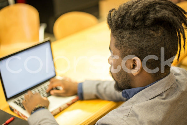 Hipster on a laptop computer - Colorstock™  © Shea Parikh  - diverse stock photos