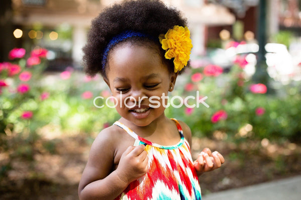 Little girl with flower in her hair - Colorstock™  © Latoya Dixon  - diverse stock photos