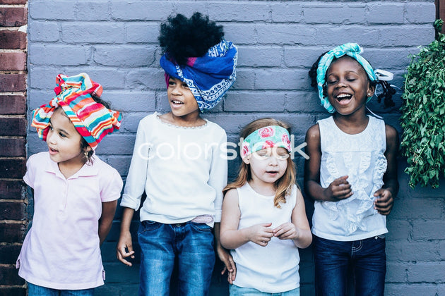 Little girls standing against the wall - Colorstock™  © Latoya Dixon  - diverse stock photos