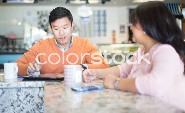 Man and woman having coffee - Colorstock™  © Shea Parikh  - diverse stock photos