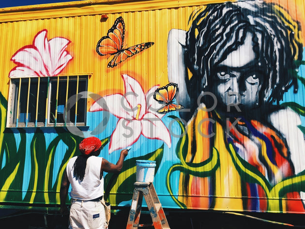 Man painting street art - Colorstock™  © Jenell Hairston  - diverse stock photos
