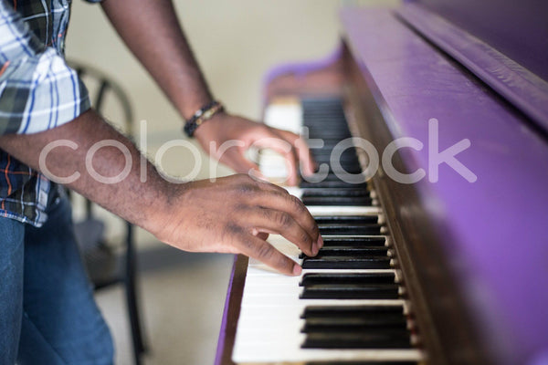 Man playing a piano - Colorstock™  © Shea Parikh  - diverse stock photos