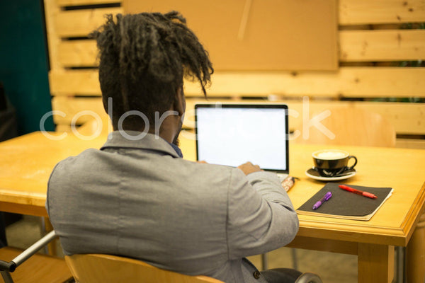Man studying for an exam - Colorstock™  © Shea Parikh  - diverse stock photos