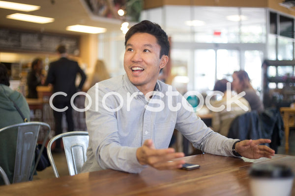 Man talking to someone out of view - Colorstock™  © Shea Parikh  - diverse stock photos