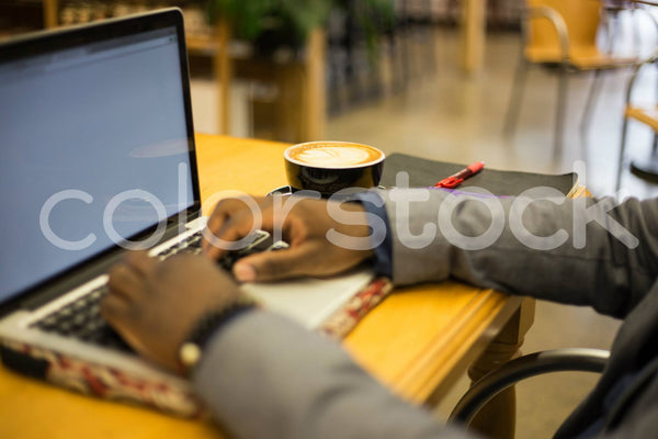 Man typing on laptop - Colorstock™  © Shea Parikh  - diverse stock photos