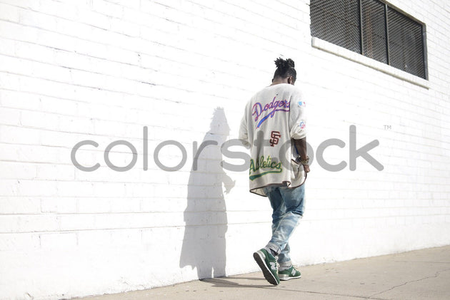 Man walking down the street - Colorstock™  © PorterhouseLA  - diverse stock photos