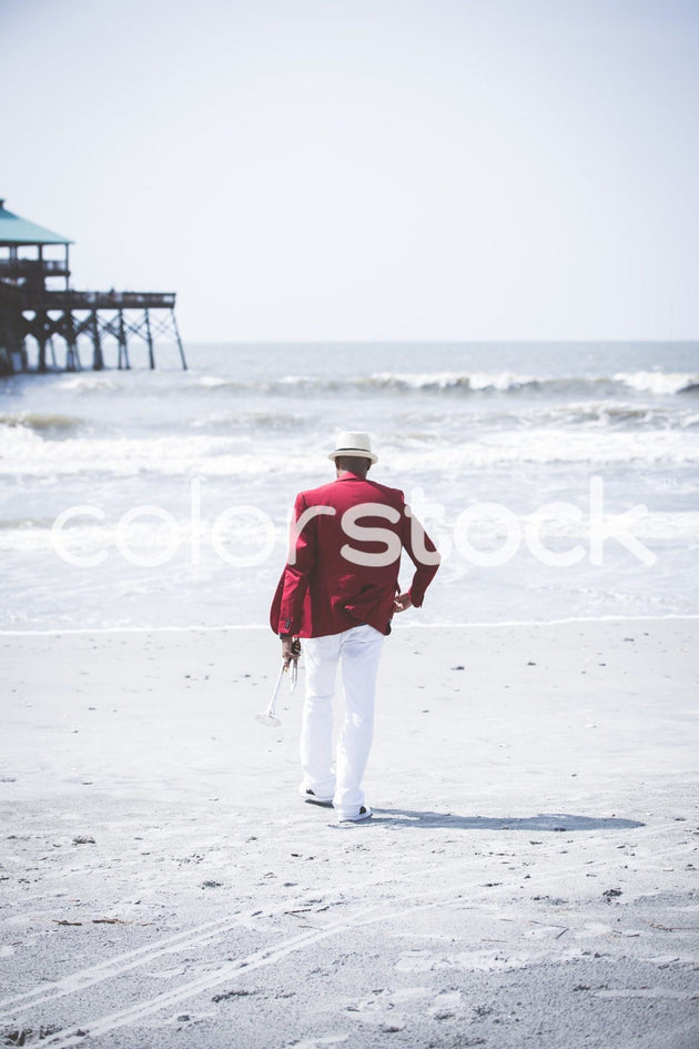 Man walking on the beach - Colorstock™  © Latoya Dixon  - diverse stock photos