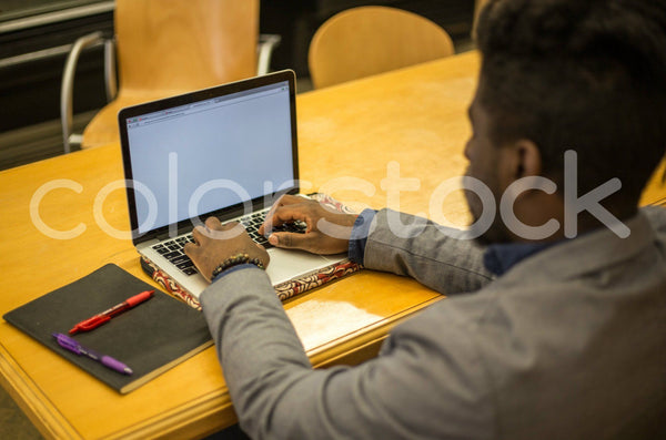Man working on a laptop - Colorstock™  © Shea Parikh  - diverse stock photos