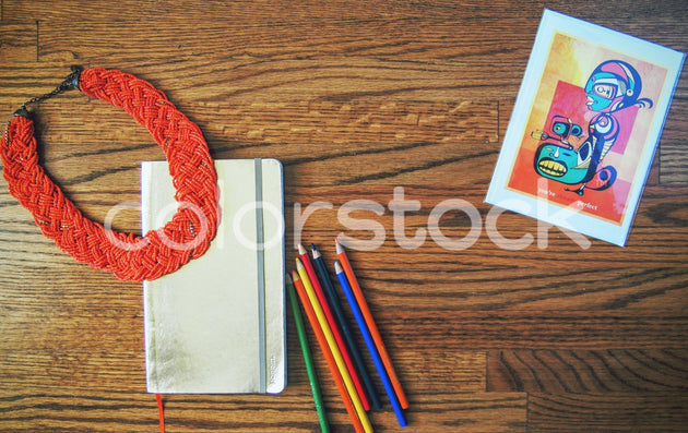 Necklace, planner, and card on desktop - Colorstock™  © Jenifer Daniels  - diverse stock photos