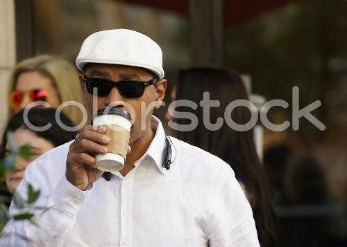 Older man with sunglasses drinking coffee - Colorstock™  © David Huff  - diverse stock photos