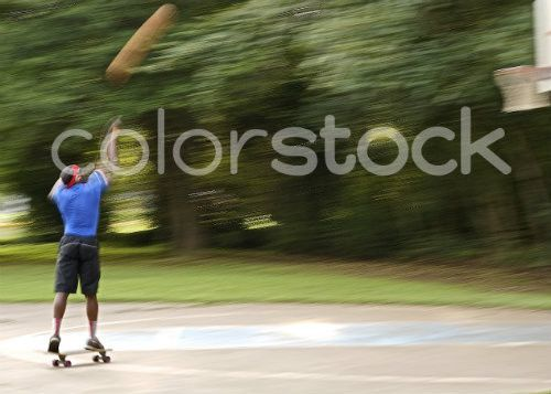 Skateboarding basketball player - Colorstock™  © David Huff  - diverse stock photos