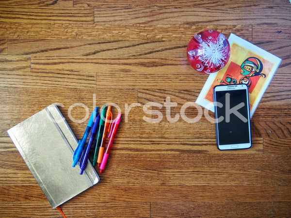 Smartphone, planner, and pens on desk - Colorstock™  © Jenifer Daniels  - diverse stock photos