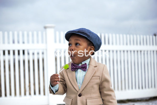 Well-dressed little boy - Colorstock™  © Latoya Dixon  - diverse stock photos