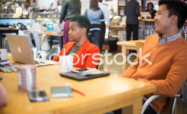Woman and man looking attentive at a meeting - Colorstock™  © Shea Parikh  - diverse stock photos