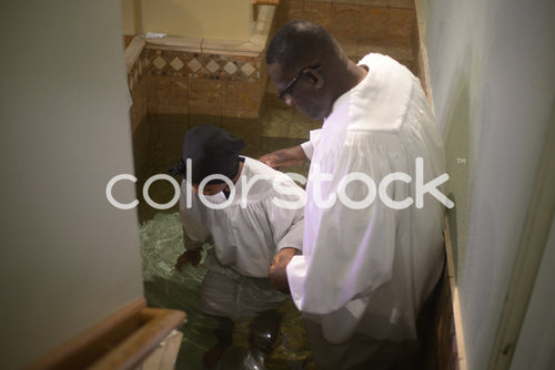 Woman being baptized in church - Colorstock™  © PorterhouseLA  - diverse stock photos