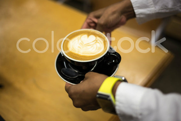 Woman carrying a mug of coffee - Colorstock™  © Shea Parikh  - diverse stock photos