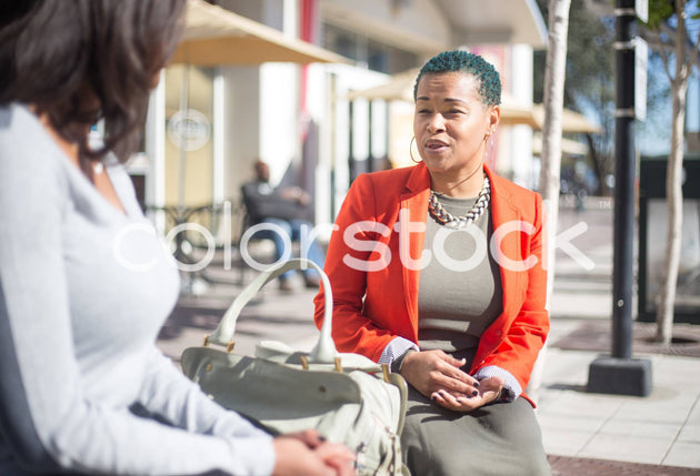 Woman having a conversation - Colorstock™  © Shea Parikh  - diverse stock photos