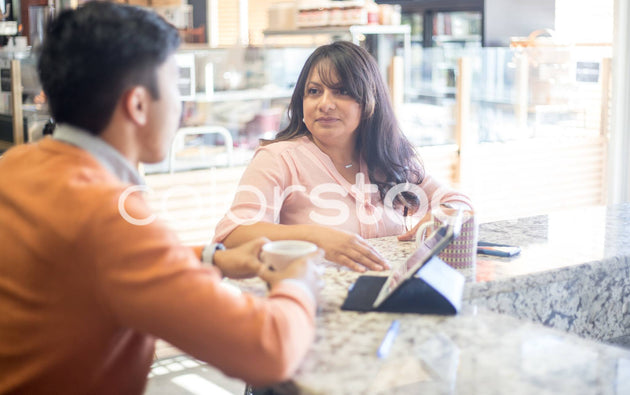 Woman in meeting at cafe - Colorstock™  © Shea Parikh  - diverse stock photos