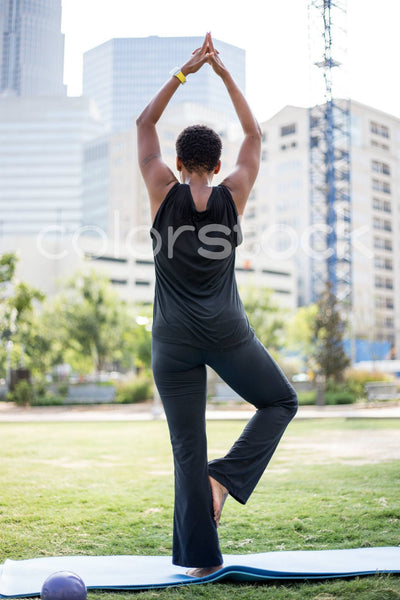 Woman in yoga and stretching in park - Colorstock™  © Shea Parikh  - diverse stock photos