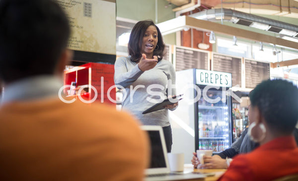Woman leading a lunch meeting - Colorstock™  © Shea Parikh  - diverse stock photos