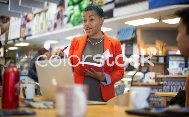 Woman leading a meeting - Colorstock™  © Shea Parikh  - diverse stock photos
