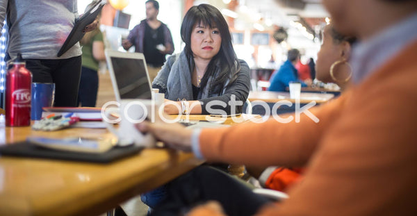 Woman listening during a meeting - Colorstock™  © Shea Parikh  - diverse stock photos