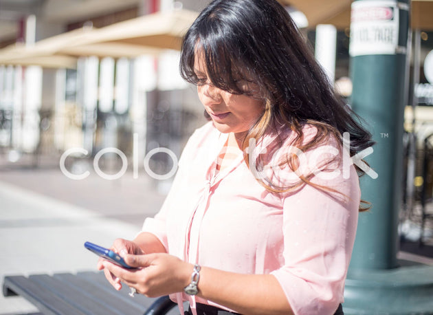Woman on her smartphone - Colorstock™  © Shea Parikh  - diverse stock photos
