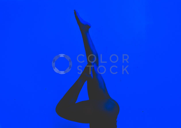 Woman pointing her legs to the sky - Colorstock™  © Spencer Greene  - diverse stock photos