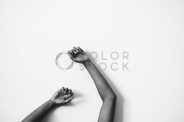 Woman's arms against a wall - Colorstock™  © Spencer Greene  - diverse stock photos