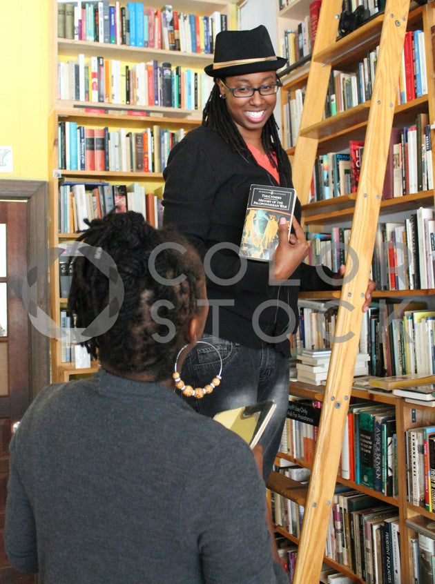 Woman sharing book in the library - Colorstock™  © Tee Dubose  - diverse stock photos