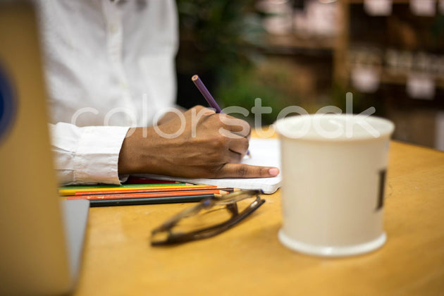 Woman sketching in sketchbook - Colorstock™  © Shea Parikh  - diverse stock photos