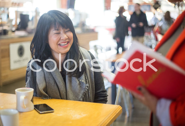 Woman smiling at friend - Colorstock™  © Shea Parikh  - diverse stock photos