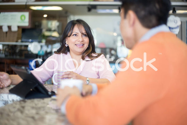 Woman speaking with colleague - Colorstock™  © Shea Parikh  - diverse stock photos