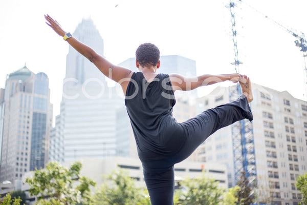 Woman stretching in city - Colorstock™  © Shea Parikh  - diverse stock photos
