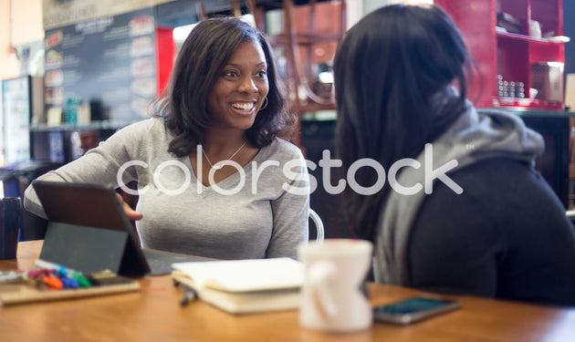 Woman talking to friend - Colorstock™  © Shea Parikh  - diverse stock photos
