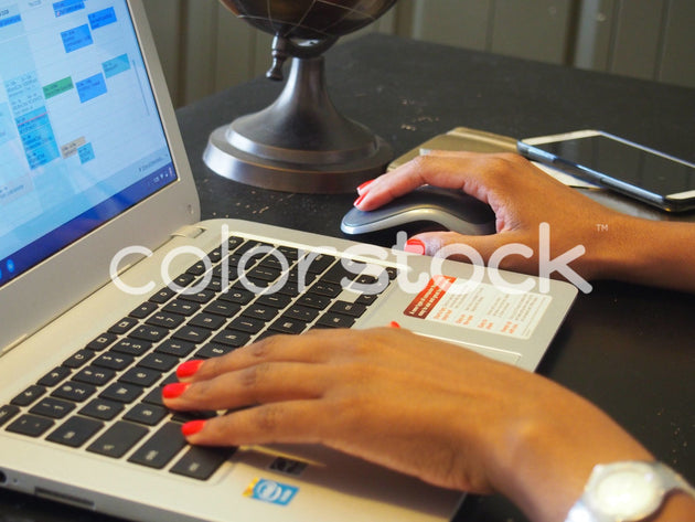 Woman typing on laptop at her desk - Colorstock™  © Jenifer Daniels  - diverse stock photos