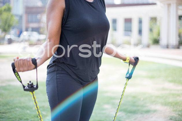 Woman using exercise equipment - Colorstock™  © Shea Parikh  - diverse stock photos