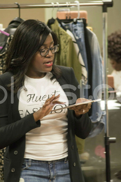 Woman using tablet at a trunk show - Colorstock™  © Integrative Flash  - diverse stock photos