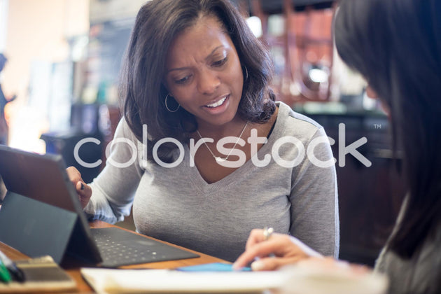 Woman viewing product on smartphone - Colorstock™  © Shea Parikh  - diverse stock photos